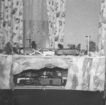 Image of Seigford 1949 Christmas Layout - A Christmas layout with mostly Lionel trains, also shown is a Pittman kit built trolley car.
