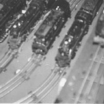 Image of Seigford Attic Layout. - An attic layout of Lionel O gauge postwar trains.  A lineup of power, out of focus and difficult to identify.