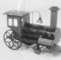 """Image of Vulcan - Ives Mfg. Co. Vulcan locomotive, black, red, green & blue with gold trim and iron wheels.  It was 8-1/2"""" long, 4"""" wide and 6-1/2"""" high. Circa 1870-1880.  This picture appeared in the Train Collectors Quarterly of July 1965, Volume 11, #3, page 6."""