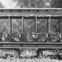 """Image of Lionel Summer Trolley - Lionel #303 Summer Trolley with open vestibules produced in 1910-1914, customarily found in dark olive green with cream clearstory roofs and maroon frame. Lettering reads """"Electric Rapid Transit"""" Also produced with """"The Lionel Lines""""."""