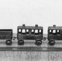 Image of French diecast passenger train set. - French diecast passenger train set.  Manufacturer unknown, circa 1910-1920.  Hook and eye couplers cast into each piece.  Information provided by Rick Ralston.  This photograph was published in the TCA Quarterly.