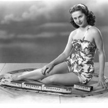 Image of Lionel Streamliner with Actress Martha Hyer - Actress Martha Hyer shown with a Lionel E636WE streamliner of the 1930s.
