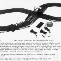 """Image of Louis Marx & Co. Sky Driver Jump Slot Racing Set - Louis Marx & Co. #22753 Sky Driver Jump Slot Racing Set.  This is a 1/32nd scale figure eight , over and under track  that measures 5'-8"""" X 30"""".  It has Willard & Novi Special race cars.  Included were power pack and two trigger style hand controllers."""