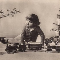 """Image of """"Froeliche Weihnachten,"""" Child with Toy Train - """"Froehliche Weinachten,"""" Child with toy train next to Christmas tree.  German postcard.  Trains are Marklin:  #2316 signal (1904-1908), #1895 gondola car (1905-1908), Marklin Spur-O-Locomotive c. 1900 with #1801 tender.  Bing #13536 coach (1904-1914).  Trains identified by Jim Yocum."""
