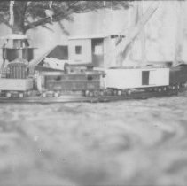 Image of Crane on Toy Train Layout - Photo of crane with toy train floor layout.