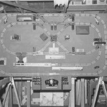 Image of Art Truman Track Layout - An Art Truman Lionel track layout 5x9 center panel. Visible in the print are a 252 crossing gate set, 153 block signal, 356 operation freight station, 455 oil derrick, 442 switch tower, 394 rotary beacon, 452 signal tower, 3656 cattle platform, 145 gateman, 3462P milk platform, 362 barrel loader, 397 coal loader, 456 coal ramp, 364 log loader and a 151 semaphore. All items from 1-7-08-01 to 1-7-27-02 are photographs or data on Art Truman layouts.