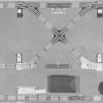 Image of Art Truman Track Layout - Art Truman 4' x 8' Lionel track layout. Visible in the picture are a milk platform, KW transformer, 132 station, 3656 cattle platform, 138 water tank and a 153 block signal. All items from 1-7-08-01 to 1-7-27-02 are photographs or data on Art Truman layouts.