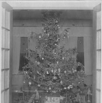 Image of Toy Train Layout Under Christmas Tree - Circa 1920's photo of standard gauge toy train layout under Christmas tree with 