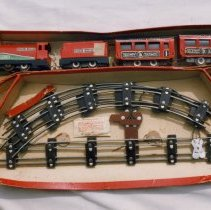 """Image of Baxtoy images - A Baxtoys train set manufactured in the early post war period.  Advertised in """"Games & toys"""" of Sept. &  Oct. 1949.  Set was powered by a 6v DC motor & used a rubber band drive to the wheels.  Track gauge was either 28mm or 32mm.  Manufacturer was William Back & Co. LTD, London, England.  Set of prints includes P99.2.7r to P99.2.7w.  P99.2.7t shows the box cover of Gammages version of the same loco with freight cars."""