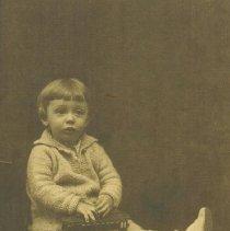 Image of Boy Holding Toy Trolley - Boy  holding Voltamp trolley car circa 1915-20.