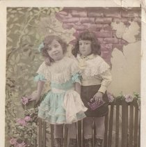Image of Aren't We Pretty - Two girls in a post card photograph with JEP (french) O gauge passenger cars as props.