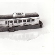 Image of Lionel coach as a diner. - Home made diner using a Lionel #617 coach from the Flying Yankee train set.  There is a duplicate set of prints.  Photograph research by Jim Yocum