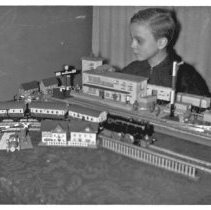 Image of Young German Boy with Toy Train Layout - Young German Boy with Toy Train Layout, file contains a 3-1/2 X 5-3/4 print made from the original negative.