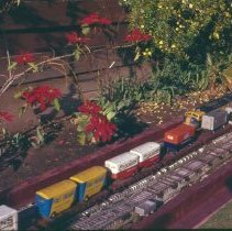 Image of Golden Bear Lines - Outdoor Train layout (Golden Bear Lines) of George Brown in Los Angeles, CA. Track is believed to be Standard Gauge, 2 rail.  All track is hand laid on wood ties with the rail rolled by George, he also built all of the equipment.