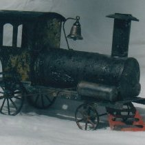 Image of Hull & Stafford Locomotive - Tin pull toy locomotive by Hull & Stafford Mfg.  Photograph research by Jim Yocum.