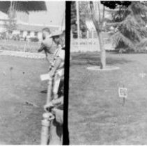 Image of Two Scenes of Outdoor Railroad - Photo negative depicting two scenes in the outdoors with a toy train running on track in the grass.  4 X 6 prints are also in file.