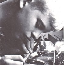 Image of Building HO car kit. - Young boy in the process of building an HO gauge Texaco tank car.