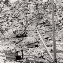 Image of P27012 - black and white print of the Pinecrest dam site showing two porter locomotives in the background.