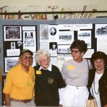 Image of P27708 - Centennial Celebration - Eleanor McAllister Golly, Frank Borrengo, Sharon Marovich, Agnes Scott Rosasco in the Sonora High School Library. They are all standing together in front of the displays, including the clothes display model.