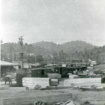Image of P28884 - Carts in the yard loaded with lumber in the early 1900's. The carts have steel wheels. West Side Lumber Company.   The negative is made from the copy of a print.