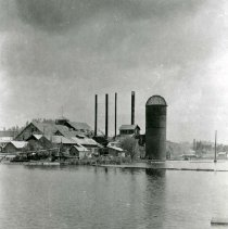 Image of P28946 - The mill pond flooded but clear of logs. With the mill in the back ground in Tuolumne. West Side Lumber Company.  The negative is made from the copy of a print.