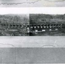 "Image of P28952 - A panoramic view of the rail trestle next to the empty mill pond at Westside Lumber. Train's load is sugar pines.  Note on the negative says: "" Sugar Pine Logs, West Side Lumber Co.  Tuolumne, Cal. "". The negative shows more detail. West Side Lumber Company.