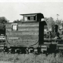 Image of P29012 - A Caboose set at the West Side Cherry Valley Railroad Theme Park in Tuolumne. Received from the West Side Lumber Company. There's a steam donkey in the background. 
