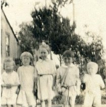 Image of P29517 - A small black and white photo of five kids standing in line for their photos. Some of the faces can be seen, but the photo is blurry. The three in the middle (from left) look like Emily and Catherine Gordon, and Jess Brown.