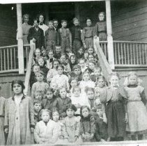Image of TP1143 - Group-School, Summerville.  Everybody is in front of the school entrance. The teachers might be at the top on the porch on the left.
