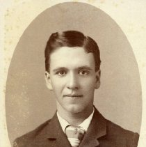 Image of TP1618 - Unidentified young man.  He is wearing a suit jacket, shirt and tie.  His hair is parted on the side.