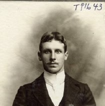 Image of TP1643 - Unidentified man.  He is wearing a suit jacket with vest, tie and high collared dress shirt.  He has a mustache and his hair is parted in the middle.