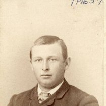 Image of TP1657 - Unidentified man.  he is wearing a suit, vest, dress shirt and tie.  His hair is parted on the side.