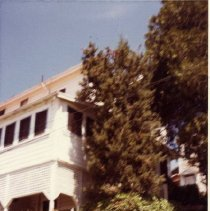 Image of TP1988 - Architecture, Smith-Morse Home 60 Pine St., Sonora, photo dated 1981. Side front appears in the photo.  The house is a three story. with front porch, sun porch and garden. The home is white clapboard with red roof, situated on a slope. Sharon Marovich collection