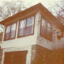 Image of TP1989 - Architecture, exterior- Webster-Meuli home, 173 W. Bradford. Sonora. Photo taken 1981.  Corner of home with what appears to be a garage, rock siding, two double sash windows facing  front and one on the side above the rock siding,
