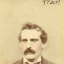 Image of TP2037 - Portrait- Man. Wearing a tuxedo. He has a heavy moustache, and red cheeks.