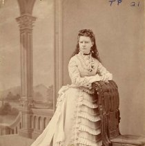 Image of TP21 - Annie Carter Markley a.  Photo dual tone b. Woman in wedding dress c.  Woman leaning on back of a chair d.  Professional photography studio e. Sister of Delia Carter Neale, born at Chinese Camp-daughters of George & Mary Carter, pioneers to Chinese Camp in the early 50's