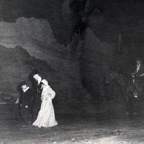 Image of TP2162 - Group- Saddened woman, man and child. Man on horseback following, not identified. Tuolumne County Gold Centennial Celebration. 1849-50---1949-50