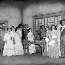 Image of TP2188 - Group-in an office receiving a paper. Not identified. Tuolumne County Gold Centennial Celebration. 1849-50---1949-50.