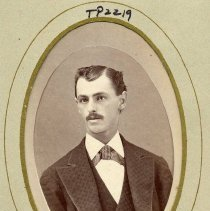 Image of TP2219 - Portrait - Man with a vest, Windsor tie, mustache and his Hair parted on side. Not identified. Part of the Cady family Album.