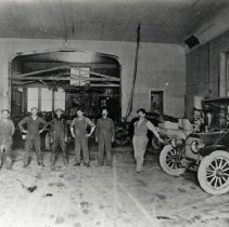 Image of TP2294 - Building - Interior of Opera Hall Garage with a group of men and some cars.