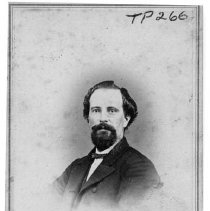 Image of TP266 - Unidentified middle aged man. a.  Photo, black and white. b.  Dressed in dark, three piece suit. c.  Bearded.