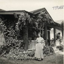 Image of TP2889 - A black and white photo of an unidentified young lady (possibly Hammill Family member) standing outside by residence. No information available on photo. Photo from Pat Fahey  collection.