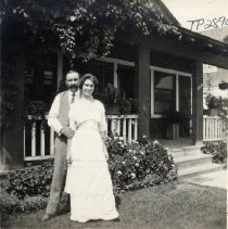 Image of TP2890 -  A black and white photo of an unidentified man and lady standing outside resident . No information available on photo. Photo from the Pat Fahey Collection.