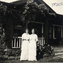 Image of TP2892 - A black and white photo of two (2) unidentified ladies standing outside in front of residence. No information available on photo. Photo from the Pat Fahey collection.