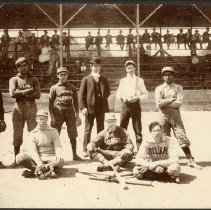Image of TP352 - Baseball Team Group Picture taken in stadium with bleachers behind them 
