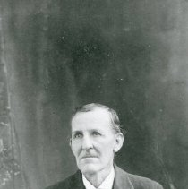 Image of TP3818 - A Black and white copy of a portrait of an unidentified man, wearing three piece suit with watch fob and chain on vest. short hair side part.