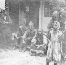 Image of TP4623 - Group- Native Americans-Joe Hampton seated center. Bill Hampton far right.  Roy Vial, foreground.