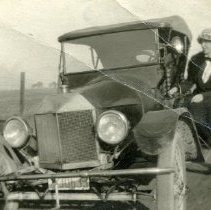 Image of TP4705 - Woman and an old car. Unidentified.  Circa 1920 - 1936