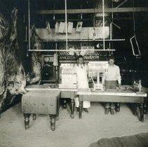 Image of TP4815 - Interior- Fred De Bernardi's  butcher shop in Jamestown, about 1920. Left- Fred De Bernardi, Right- Bill Peters (died in S.F.)