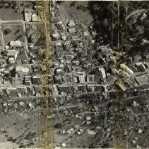 Image of TP860 - 2 photos of the aerial view of Sonora 1932. 1. Is the original. 2. Is a copy. Shows the streets, buildings and homes of down town and the out laying area. 75 millimeter film.